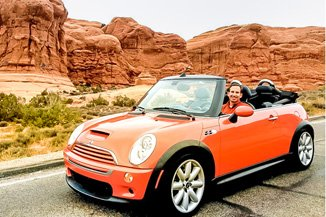 Marc in our 2006 Mini Cooper S Convertible in Hot Orange at Arches NP, Utah.