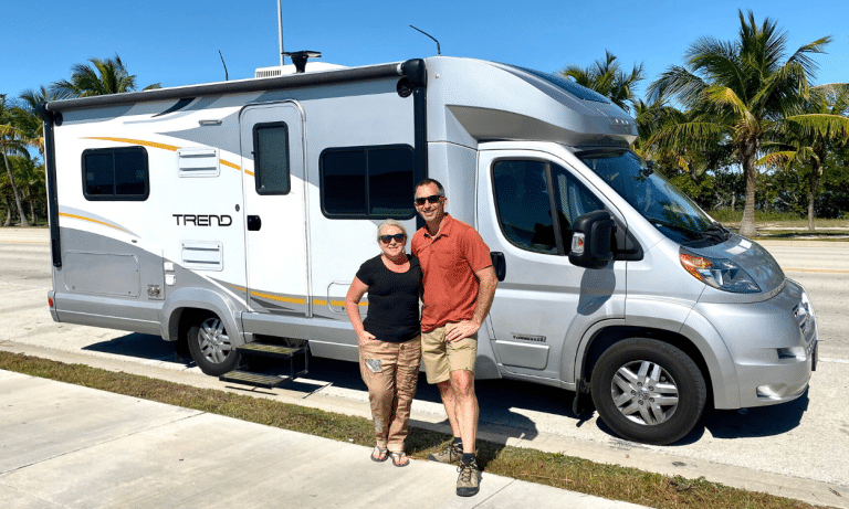 couple stand with RV Rental in key west florida