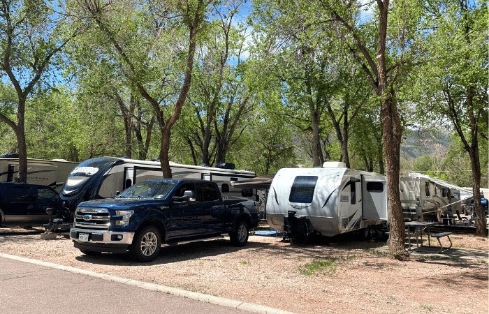 blue truck and lance camper in rv site