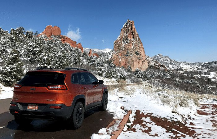 Orange Jeep with scenic drive in Garden of the Gods