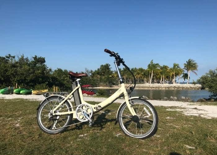 blix electric folding bike with kayaks in background