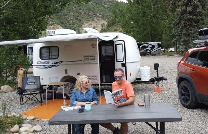 marc and julie of RVLove at campsite reading